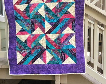 60 x 44 quilt or wall hanging.  Trade winds in multi colored pieces.