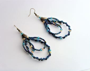 Earrings blue beads and gold.