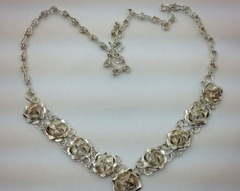Sterling silver 9 rose vintage necklace. A Mexico 925 piece.