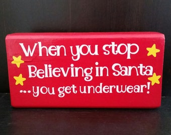 When you stop believing in santa you get underwear, don't get your tinsel in a tangle, Christmas signs