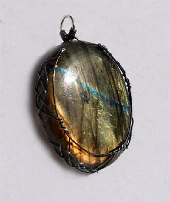 Labradorite pendant wrapped Celtic style with sterling silver and copper