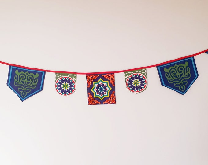 Ramadan home decoration. Fabric Bunting khayameya with 7 flags in ethnic fabric. Egyptian banner.