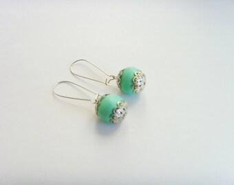 Green Earth color bead earrings.