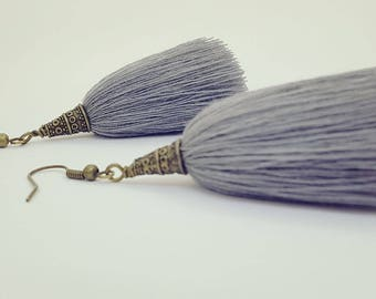 Rustic tassel earrings with bronze tone caps and hooks