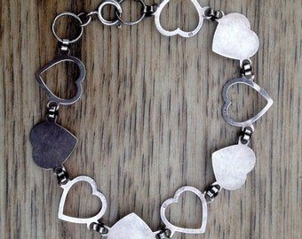Antique sterling silver chain of hearts bracelet