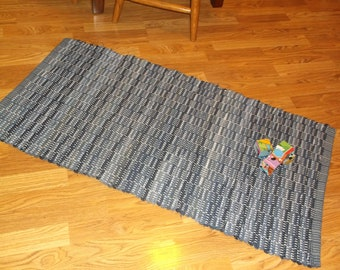 Hand-woven, rag rug made of recycled denim.