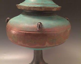 Lidded pedestal rustic copper bronze container