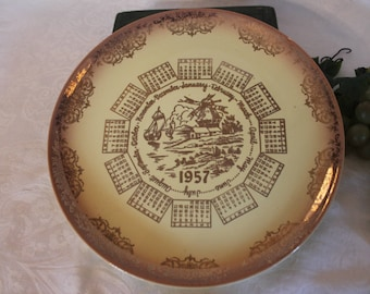 """1957 Taylor Smith Taylor Yellow and Gold 10.25"""" Dinner Plate featuring the Calendar and Dutch Scene"""