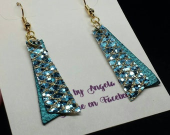 Teal faux leather earrings with teal and gold glitter layer.