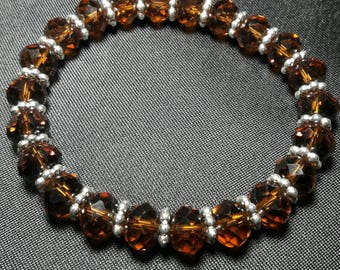 Elegant root beer brown crystal bracelet with silver accents. **Sale**