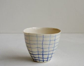 Organic porcelain cup Nr. 2 - white with cabalt blue checkered design.