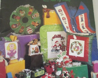 """Diy vintage cross stitch and quliting book softbound """"Mistletoe Express"""" used Craft Book 41 pages"""