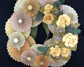 yellow and gold paper rosette wreath with yellow roses and custom curly flowers