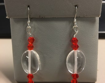Clear and red earrings