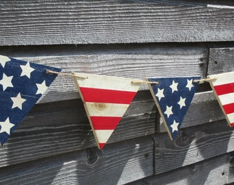 4th of July banner.  Independence day home porch decor, pennant style wooden banner.  Fourth of July party decoration.  Stars & stripes.