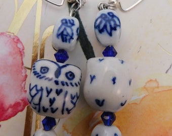 Ceramic white and blue owl earrings with blue glass beads