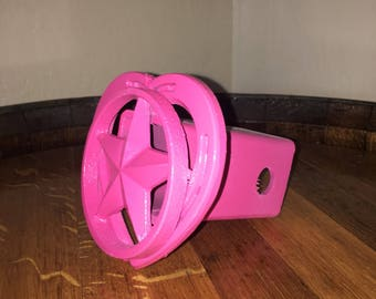 Special edition breast cancer awareness horse shoe receiver hitch cover.