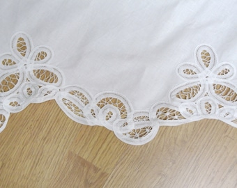 Very well done vintage 1980s handmade band-embroidery frame on white cotton curtain coat