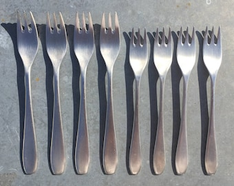 Emperor mid century design: stainless steel dessert or cake forks, 4 each in the set, large size still available. Circa 1970s.