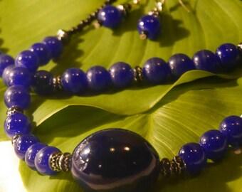 Set, blue glass necklace