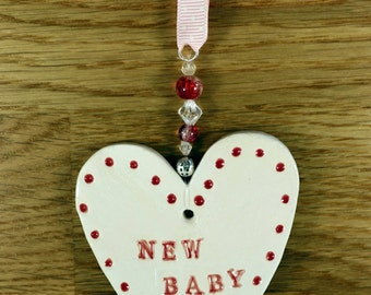 New Baby Girl Pottery Heart Gift, Great Baby Shower Gift to say Congratulations. Hand Painted with red & white glazes in my Sussex pottery.