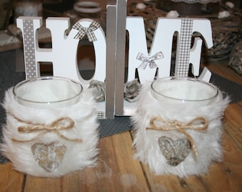candle in glass and white fur heart and rope