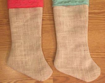 Cream colored burlap christmas stockings.