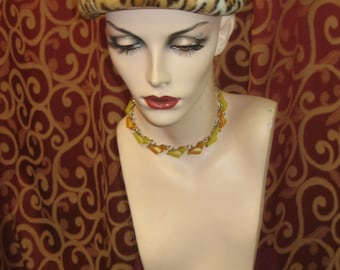"""1950's, 22"""" round, cone shaped hat, of rabbit fur stenciled leopard"""