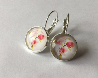Earrings flower pattern, background white bouquet of roses.