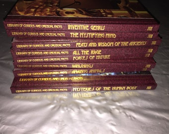 8 Volumes of the Series Library of the Curious and Unusual