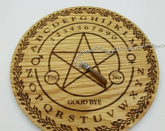 Pendulum Dowsing board engaved with a Penticle and free Pendulum