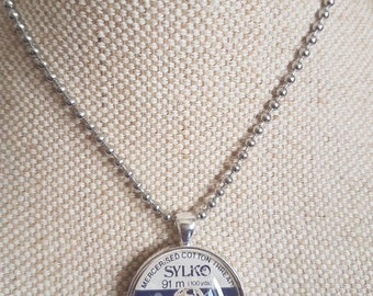 Sylko pendant / sewing theme gift / silvertone cabochon pendants / upcycled cotton thread labels / colour  ELEPHANT/ oops