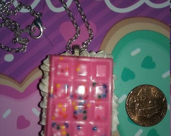 pink chocolate bar with frosting charm