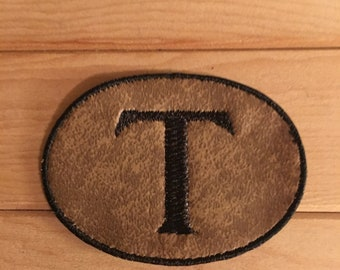 Tan Monogram with Brown Embroidery: Letter T.