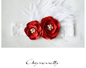 CCC015 - White baby girl lace headband with red satin flowers, off white pearls and white ostrich feathers.