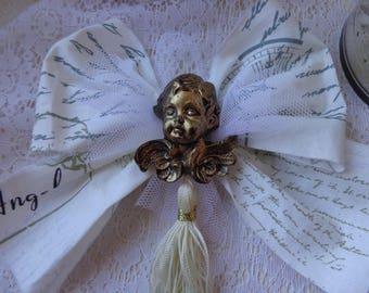 Noeud romantique à suspendre au sapin de NOEL avec tête d'ange en résine dorée