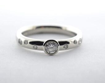 Platinum OED .25ct Round Bezel Set Diamond Engagement Ring - Size 6.5