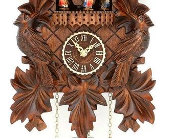 Cuckoo clock turning dancers, bird-12 tunes-Black Forest