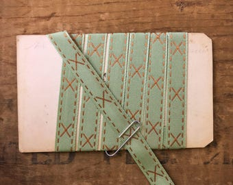 3/8 Inch Olive Green And Copper Ribbon Trim With Embroidered X's And Dashed Border (1yrd.) T32