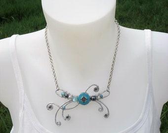 Necklace - turquoise blue enamel bead and hematite stone necklace