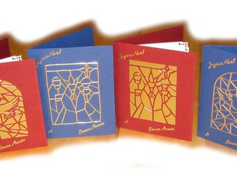 Set of 4 Christmas cards, 2 red and 2 blue, greetings, gold stained glass patterns.