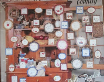 """1984 Cross Stitch paper pattern booklet """"50 Miniature Sayings"""" 22 pages used Country cross stitch"""