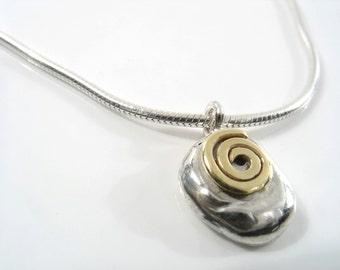 Gold spiral on Sterling silver spiral, set on a silver nugget, 16 inch snake chain.
