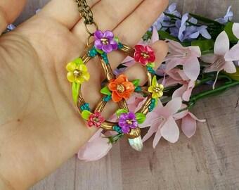 Floral peace sign necklace with aura quartz