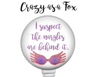 I suspect the Nargles Retractable Badge Holder,  Badge Reel, Lanyard, Stethoscope ID Tag, Nurse, RN, Doctor,  Student, Harry Potter inspired