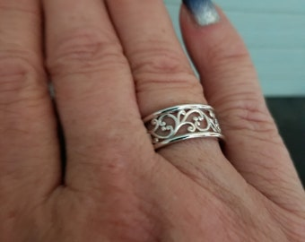 Open scroll work band, sterling size 8.5