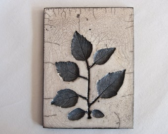 CERAMIC PLAQUE - wall hanging, raku fired, floral design, one of a kind.