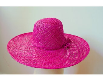 Sun Hat finely handwoven raffia with a bow on the side, Fuchsia pink color.