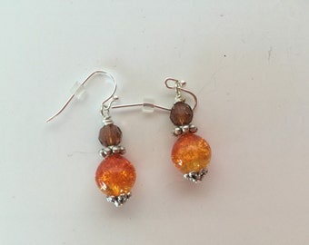 Fireball orange beaded earring made with sterling silver plated wire.