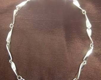Hand forged Propeller twist sterling silver linked necklace.